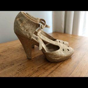 Gold t-strap heels